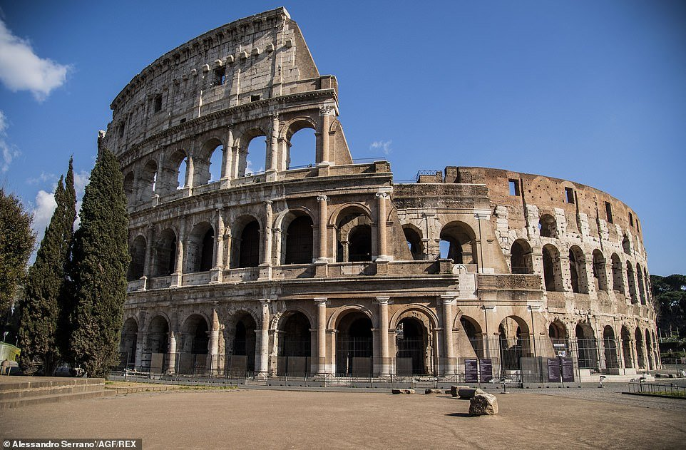 A deserted area outside the Colosseum in Rome, which is usually heaving with tourists, after Italians were ordered to stay inside unless necessary