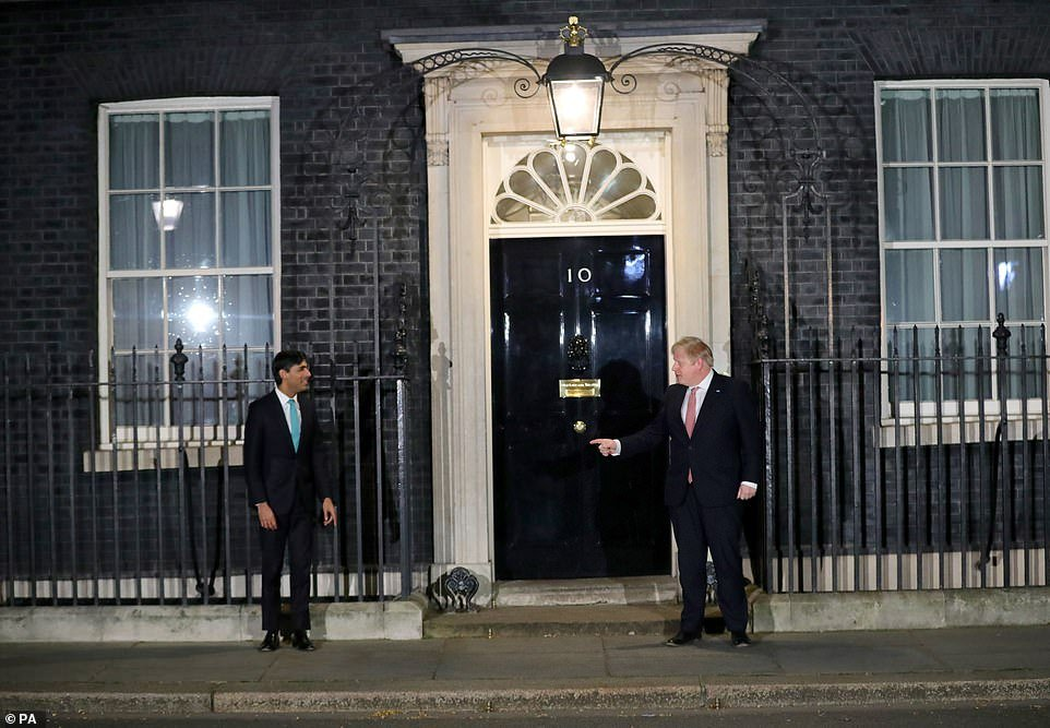 Boris Johnson was outside No10 last night applauding NHS workers who are combating the virus, in a national show of appreciation - but kept his distance from Chancellor Rishi Sunak