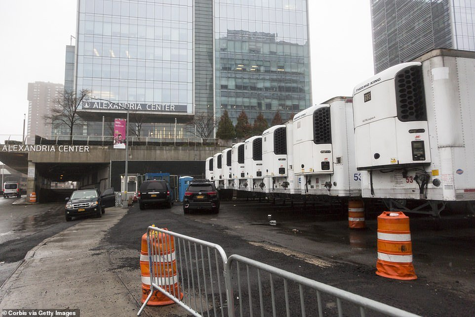 A line of refrigerated trucks that are being used as morgues sit outside Bellevue Hospital Center in Manhattan on Sunday