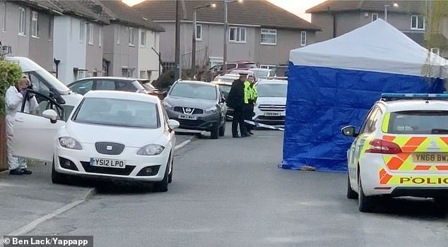 A forensics tent is now in place on the area of the pavement and road outside the marital semi-detached home where Victoria was killed