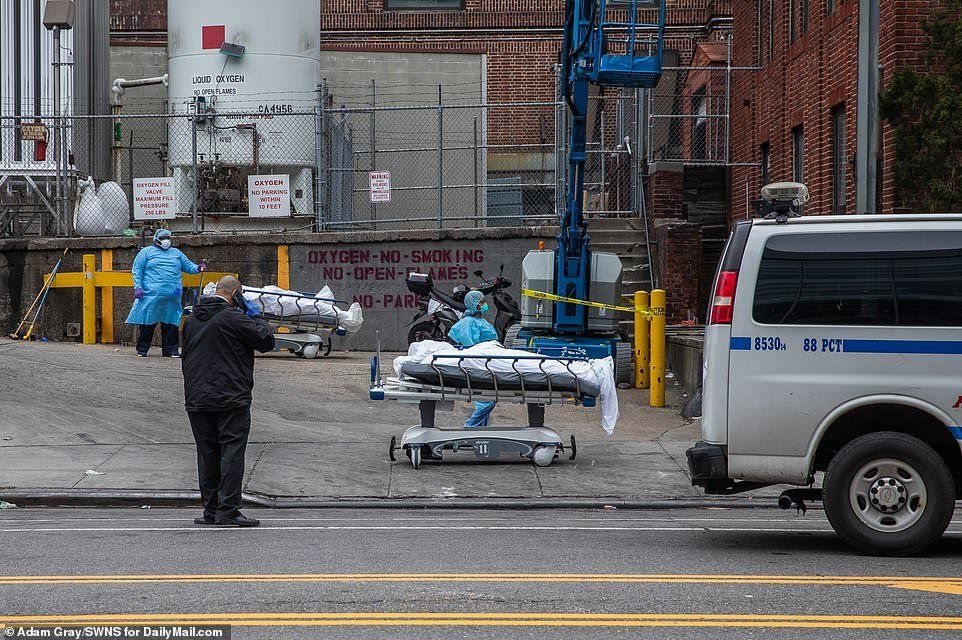 More than 3,000 Americans had died from coronavirus as of Monday night. Pictured, medical staff load bodies to a refrigerated truck outside of Brooklyn Hospital Center, New York on Monday afternoon