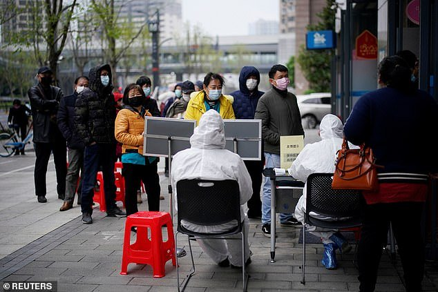 Mr Christensen insinuated coronavirus may not have accidentally come from contaminated bat meat at the wet market. Pictured are residents of Wuhan wearing face masks on March 31