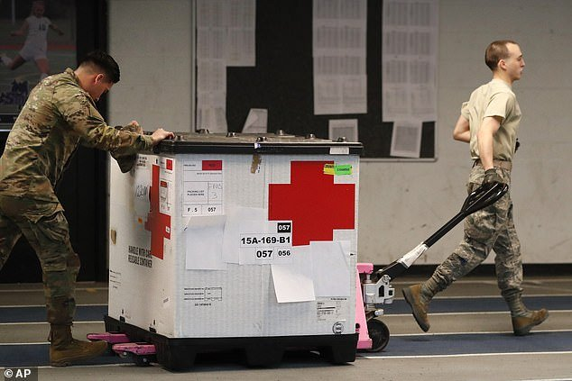 Troops move medical supplies through the Southern Connecticut State University