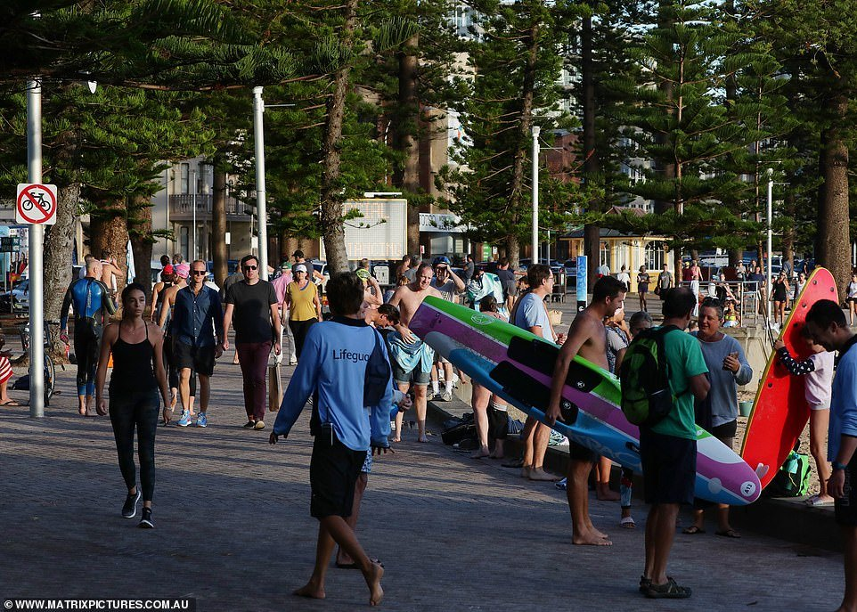 Beachgoers and residents seeking their daily dose of exercise were packed together on the boardwalk