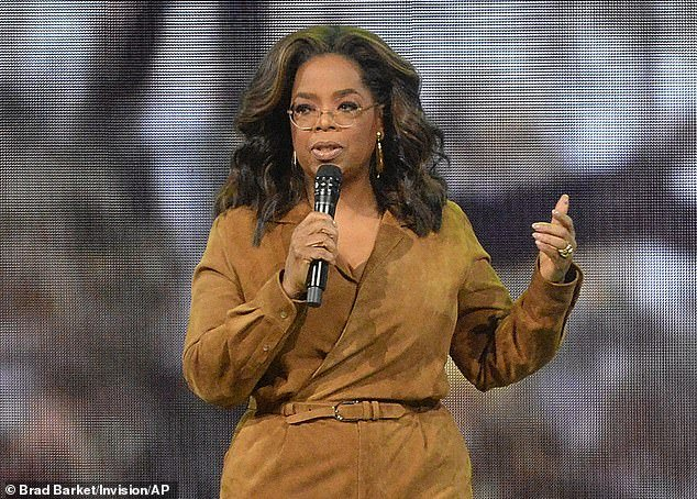 Doing her part: Oprah Winfrey is giving back to America as the pandemic continues to adversely impact life across the country (pictured February 2020)