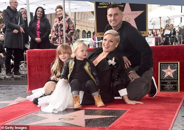 Family first: Pink is married to 44-year-old motorcycle and off-road truck racer Carey Hart as they also have an eight-year-old daughter named Willow together, as the entire family are seen here at her Hollywood Walk Of Fame Ceremony in February 2019