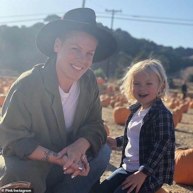 Bond: Pink has revealed that she and her three-year-old son Jameson have tested positive for COVID-19