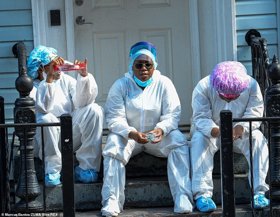 Nurses putting their names on protective clothing to be worn many times resting outside the Wyckoff Heights Medical Center in Brooklyn, NYC