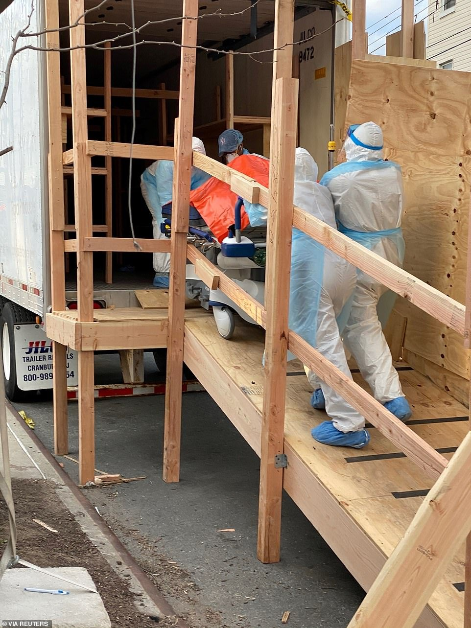 Bodies are loaded into a makeshift morgue outside the Wyckoff Hospital amid the outbreak of the coronavirus