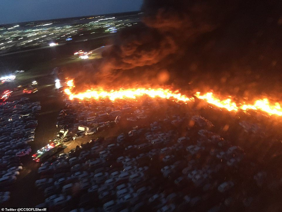 Witnesses said they heard multiple small explosions and flames leaping high into the air as the flames spread across the airport parking lot