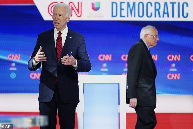 Bernie Sanders (right) said he knew that Joe Biden (left) would be the Democratic nominee, but he told supporters he would stay on the ballot in order to collect delegates so that progressive could have more sway at the Democratic National Convention