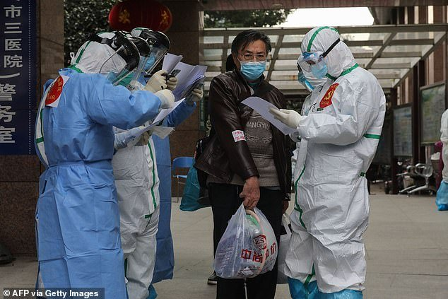 Medical staff check information as patients infected by coronavirus leave from Wuhan Hospital to Huoshenshan Hospital in March