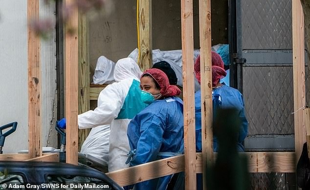 A number of bodies were loaded into a refrigerated morgue truck in Brooklyn on Friday