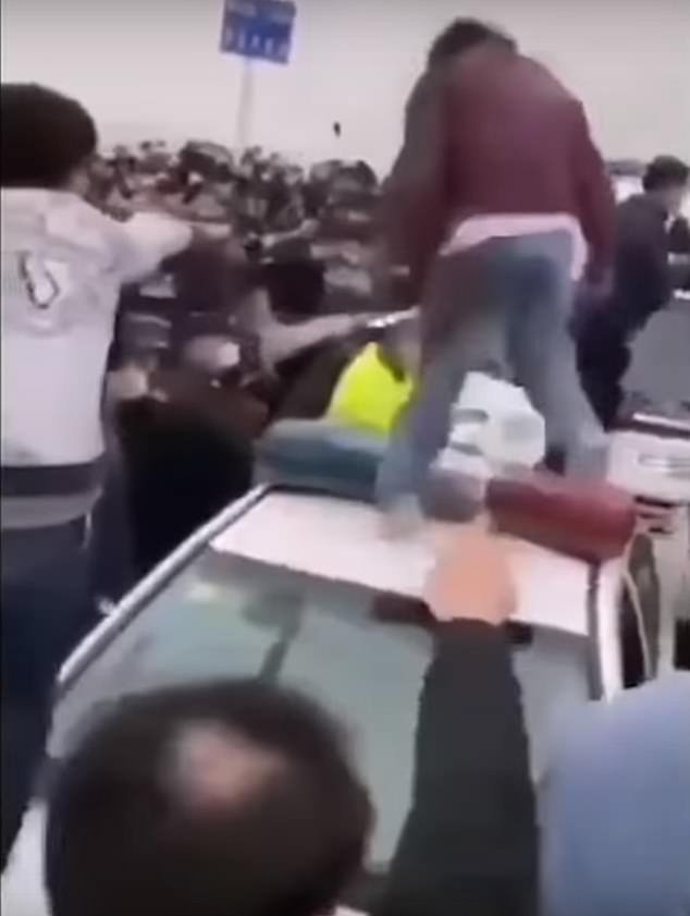 In clashes captured on video, police officers from the two provinces wrestled with each other, while people in face masks from either side of the bridge fought and overturned police cars after migrant workers without the virus were told they could once again leave Hubei for work