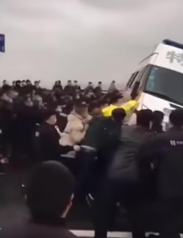 The violence erupted after barricades were reportedly set up by police to stop the Hubei workers crossing into Jiangxi where, according to government figures, there have been less than 1,000 Covid-19 cases and only one death