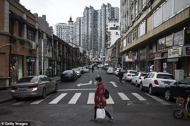 A women walking in Wuhan, Hubei Province, China, after the partial lift of the lockdown