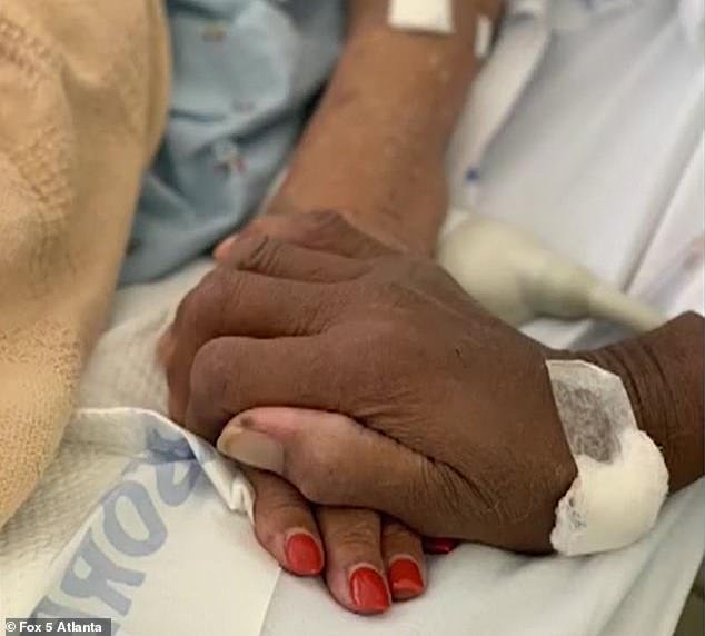 The elderly couple were seen holding hands while at the hospital in their last photo together