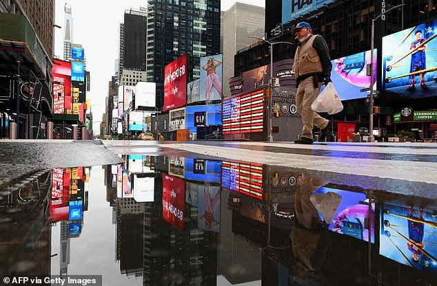 Kashkari, who oversaw the Troubled Asset Relief Program that the U.S. implemented in the wake of the 2008 financial crisis, toldAmericans to brace themselves for 18 months of shutdowns (Pictured: A man crosses the street at a nearly empty Time Square on April 9)
