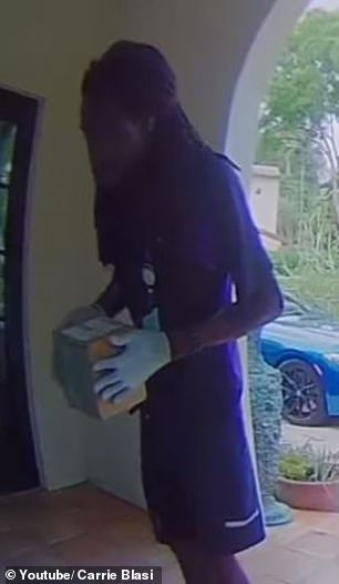 Heart of gold: FedEx delivery man Justin Bradshaw, 28, took the time to sanitize a package to protect a young girl from coronavirus after seeing a warning sign on the family