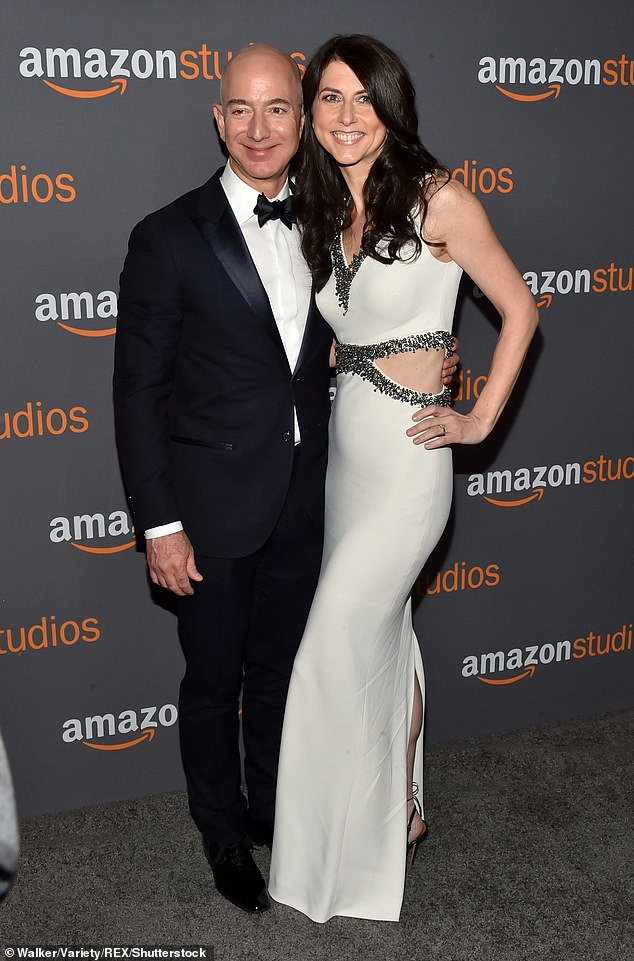 Jeff Bezos gave billion worth of stocks to ex, Mackenzie (pictured with the Amazon CEO), after their divorce last year