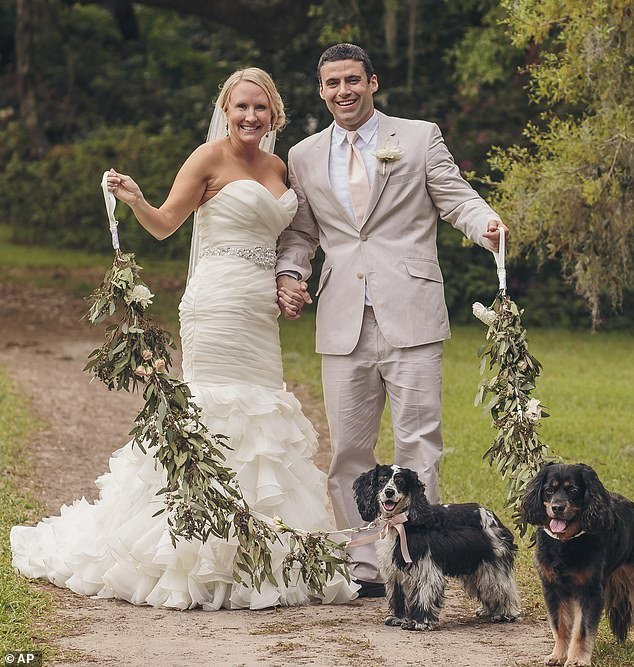 Looking back: The two nurses married five years ago, and Cayer said the image of them working at the hospital has struck a chord because