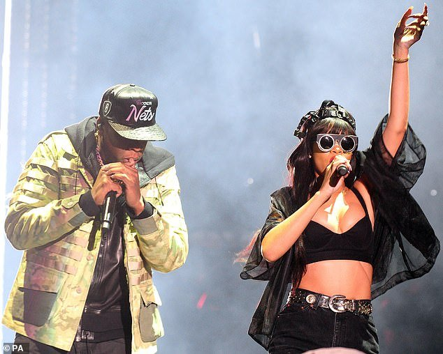 Doing their bit:Rihanna has teamed up with Jay-Z and Twitter CEO Jack Dorsey to donate .2 million to coronavirus relief efforts; the two performers are pictured onstage in London in 2012