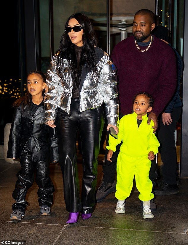 Family fortunes: Kanye pictured with his wife Kim and their children in December last year