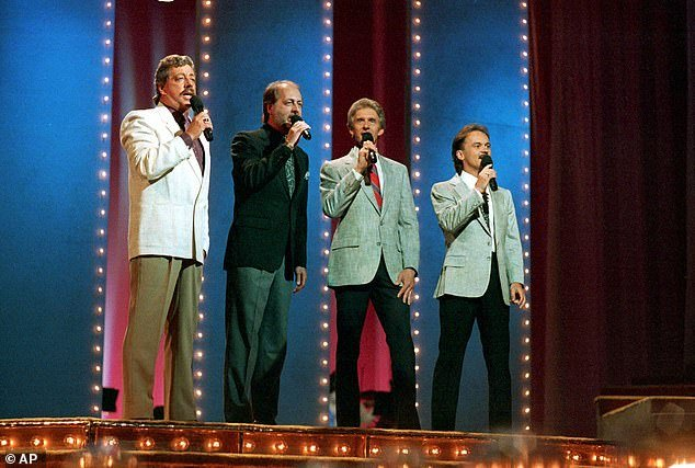 Throwback: (from left) Harold, his brother Don Reid, Phil Balsley and Jimmy Fortune are pictured performing as the Statler Brothers in 1989
