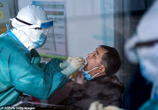 Beijing claims that the total number of confirmed coronavirus deaths in China is 4,632 people . But there is widespread disbelief of those figures across the globe by Western leaders who accuse Beijing of letting coronavirus spread across the globe while its leaders saved face. Medical personnel take swab samples of a man from a man inin Suifenhe, in China