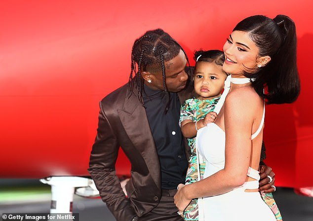Momager in training: Kylie pictured with her daughter Stormi and ex Travis Scott, who she has been self-isolating with