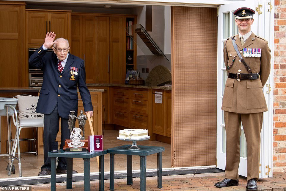 Lieutenant Colonel Thomas Miller presented the beloved war veteran with the medal - though they maintained social distancing - and Colonel Tom was given gifts and a cake to mark his centenary