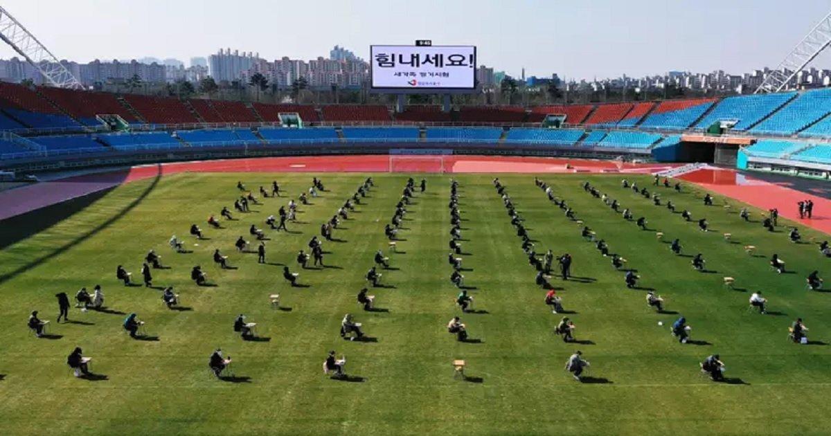 k3.jpg?resize=1200,630 - Football Stadium Used As An Ingenious Social Distancing Tool To Host Job Exams In South Korea