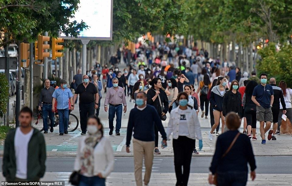 SPAIN: People walk on a street inL