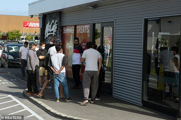 People queue outside a takeaway store last week in Auckland when restrictions were lifted after New Zealand brought the epidemic under control