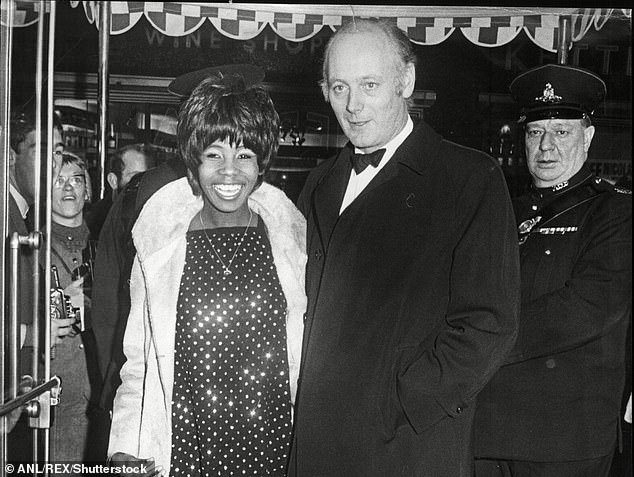 The singer arriving with Lord Montagu of Beaulieu at the Casino Cinerama Theatre in Old Compton Street, London, for the world premiere of