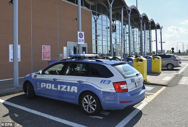 The migrant from Senegal was arrested on Sunday for allegedly raping the 48-year-old after she left work at a Naples hospital at around 3pm (file image of an Italian police car)