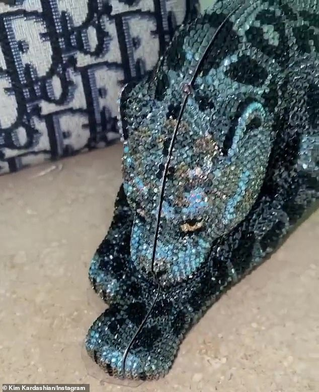 Shades of blue: Shortly after, Kim, 39, posted a video of her own matching cheetah clutch in blue, telling Kylie, 22: