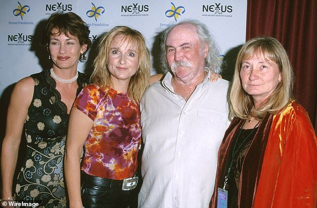 Beckett was the son of Etheridge and her former partner Julie Cypher. His biological father was rocker David Crosby. Cypher and Etheridge are pictured with Crosby and his wife Jan at an event in Santa Monica, California, in September 2000