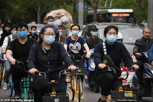 China has officially reported just 84,029 cases of the virus - though widespread doubt has been cast on this figure (file image)