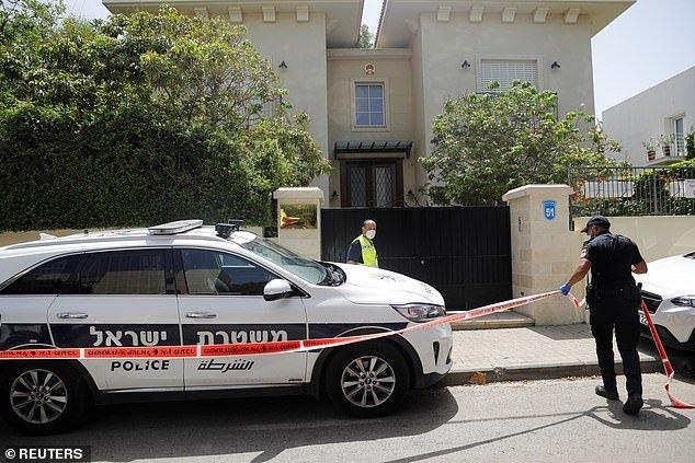 An Israeli policeman cordons off an area near the house of China