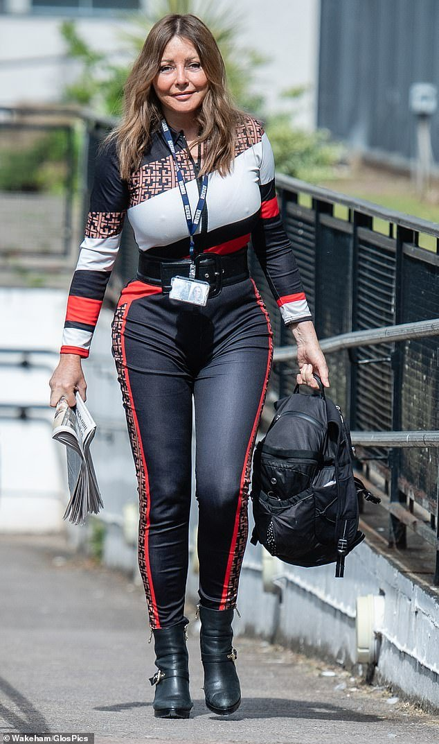 Hard to miss:Carol Vorderman, 59, was once again displaying her jaw-dropping figure on Saturday as she arrived to present her weekly show on BBC Radio Wales