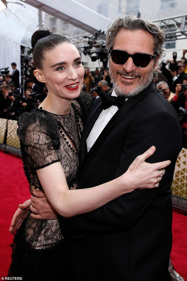 Happy news: Rooney Mara and fiancé Joaquin Phoenix are reportedly expecting their first child together (pictured in February)