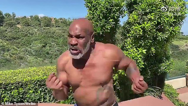 Fierce: In this new clip Tyson has sculpted arms, abs and an overall slender frame as he shows off a grey beard