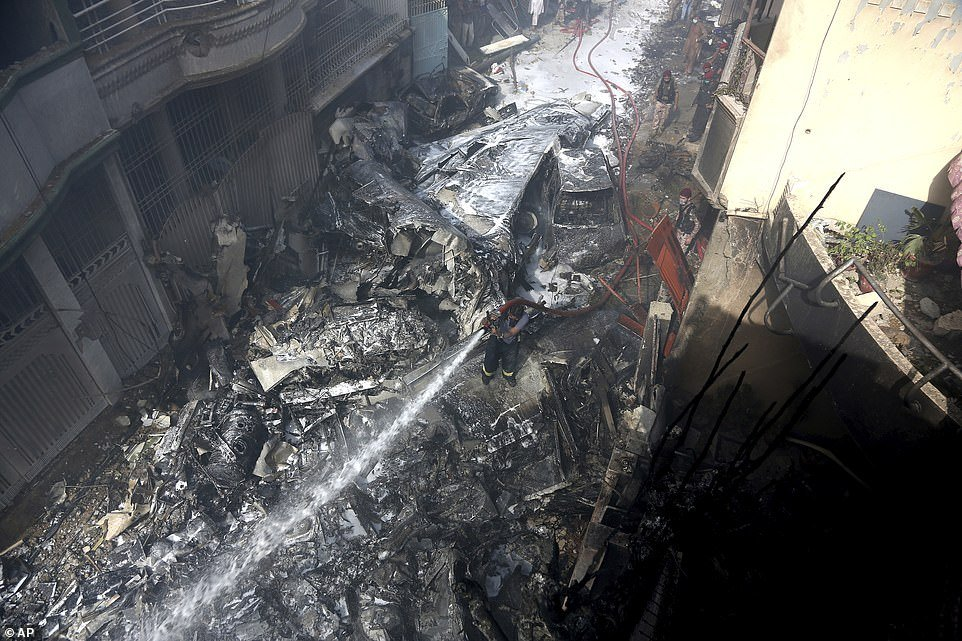 This was the scene of devastation as fire brigade staff used jet hoses to put out the fire. The plane crashed down as it approached Karachi