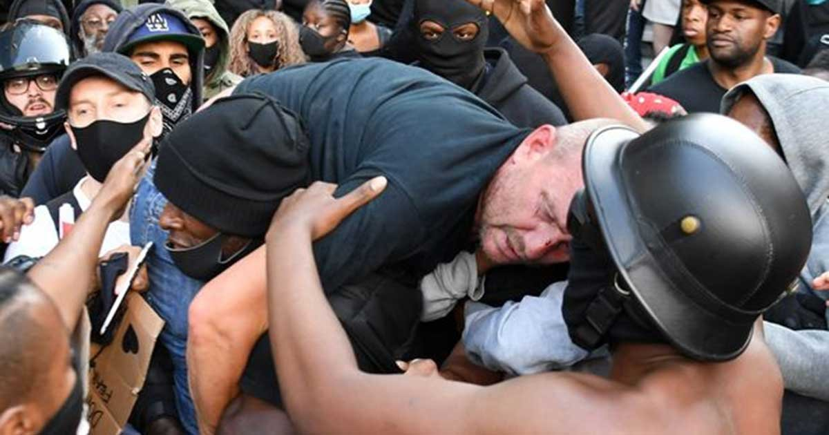 0 britain politics police protest racism.jpg?resize=1200,630 - Man Who Rescued Counter-Protester Speaks Out