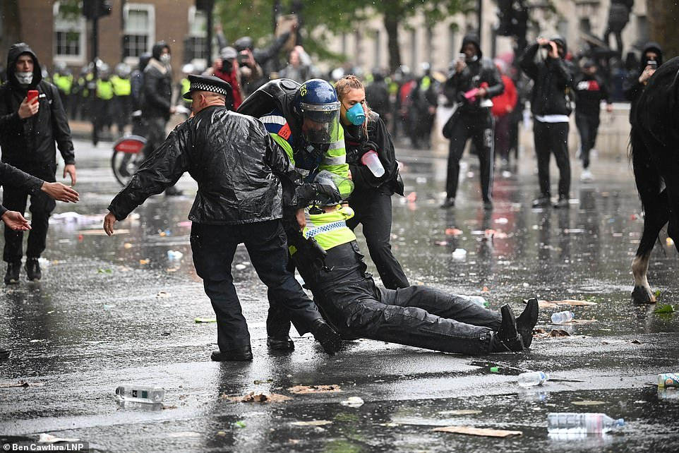 The injured officer is seen being pulled off the street by two other officers and a protestor. Met Police have confirmed she is recovering in hospital