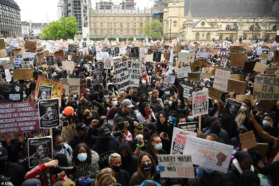 Vast crowds were seen in Parliament Square with demonstrators - mostly wearing protective face masks - clutching placards