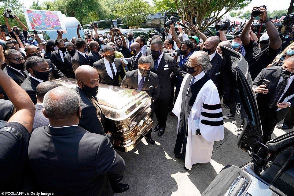 Rev. Al Sharpton looked on as pallbearers hauled Floyd