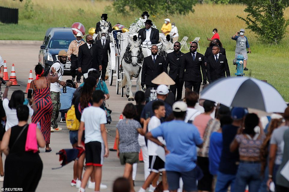 The carriage is seen on its way to Houston Memorial Gardens cemetery in Pearland, Texas, on Tuesday, following Floyd