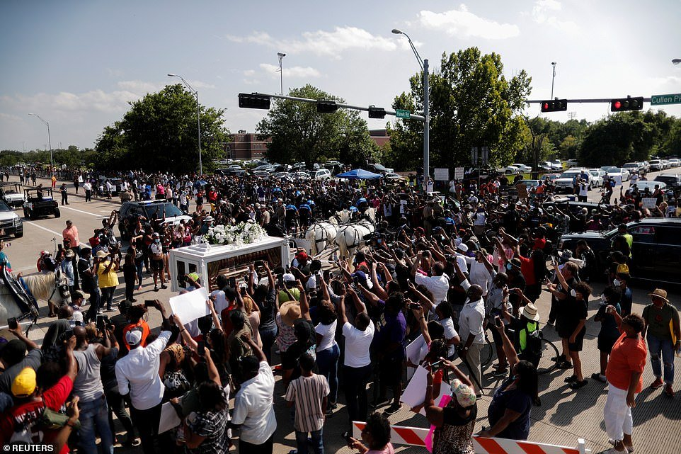 Powerful images showed hundreds raising their fists as the horse-drawn carriage headed to the Houston Memorial Gardens cemetery in Pearland, Texas